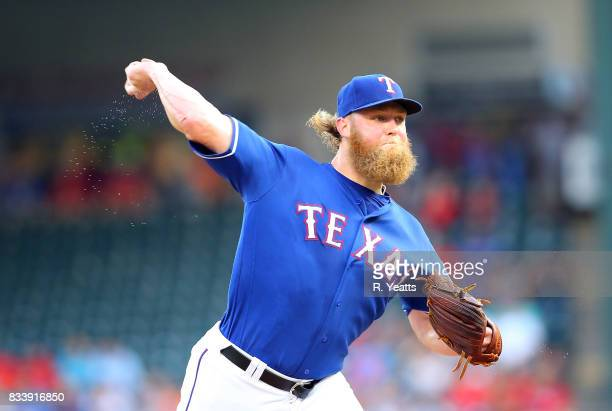 Andrew Cashner of the Texas Rangers throws in the first inning against the Seattle Mariners at Globe Life Park in Arlington on August 2 2017 in...