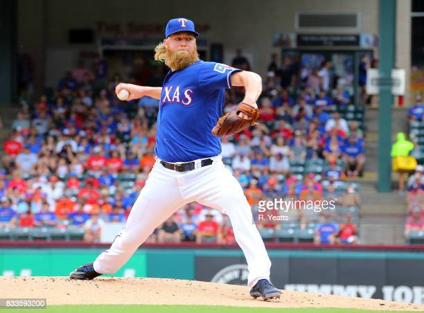 Andrew Cashner of the Texas Rangers throws in the first inning''against the Houston Astros at Globe Life Park in Arlington on August 13 2017 in...