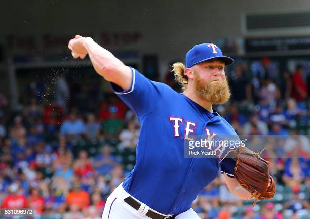Andrew Cashner of the Texas Rangers throws in the second inning against the Houston Astros at Globe Life Park in Arlington on August 13 2017 in...