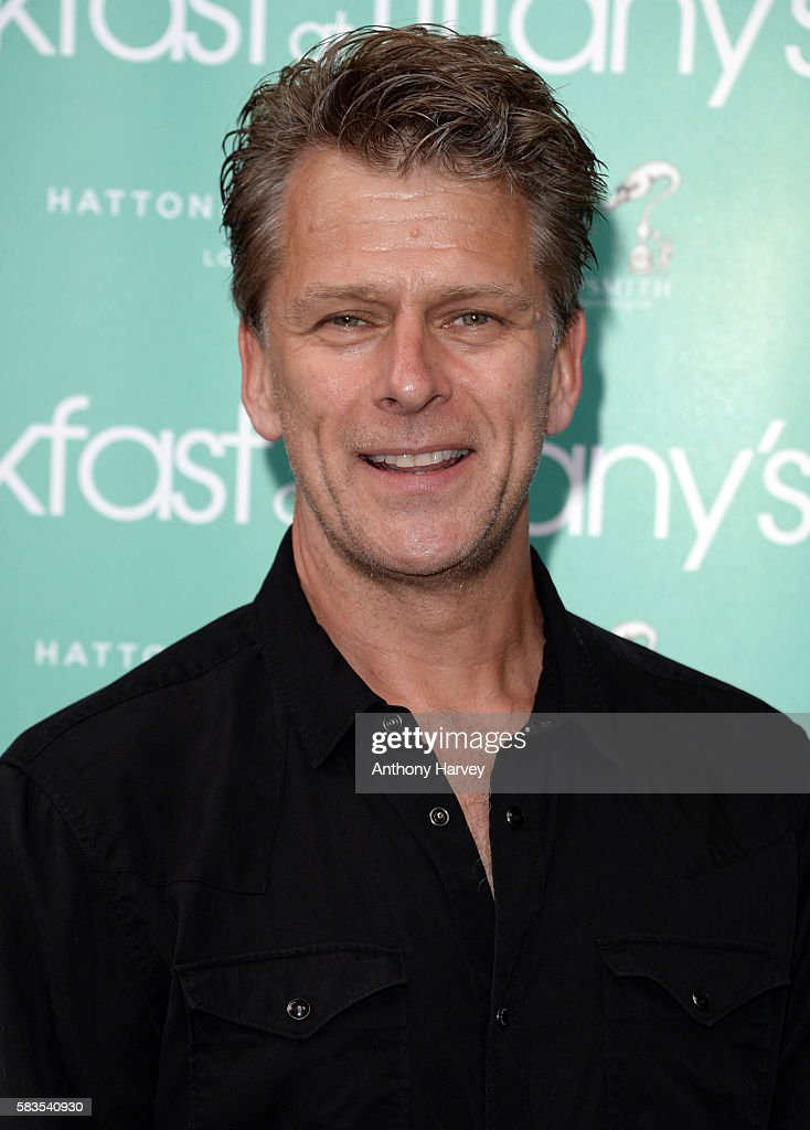 Andrew Castle arrives for the opening night of Breakfast at Tiffany's at the Theatre Royal Haymarket on July 26 2016 in London England