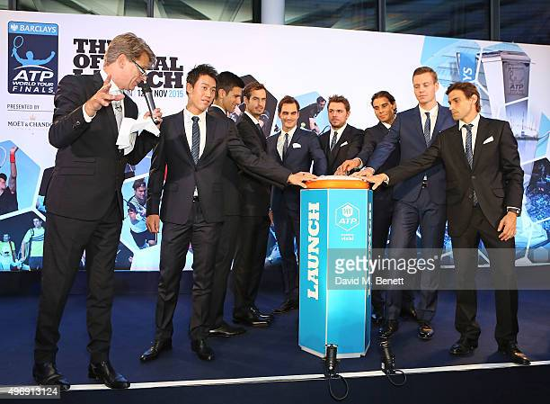 Andrew Castle Kei Nishikori Novak Djokovic Andy Murray Roger Federer Stan Wawrinka Rafael Nadal Tomas Berdych and David Ferrer celebrate with Moet...