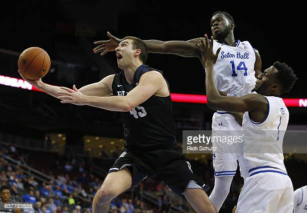 Andrew Chrabascz of the Butler Bulldogs attempts a shot as Ismael Sanogo and Michael Nzei of the Seton Hall Pirates defend during the first half of...
