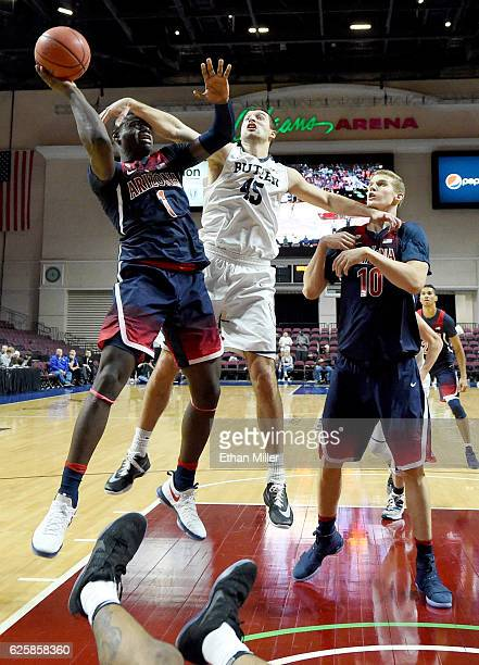 Andrew Chrabascz of the Butler Bulldogs is called for an offensive charge and gets hit by Rawle Alkins of the Arizona Wildcats as Lauri Markkanen of...