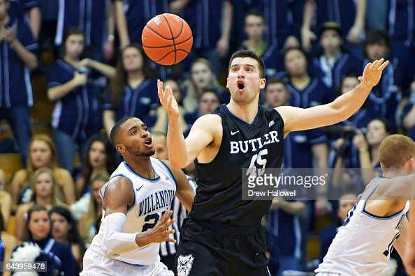 Andrew Chrabascz of the Butler Bulldogs keeps a loose ball away from Mikal Bridges of the Villanova Wildcats at The Pavilion on February 22 2017 in...