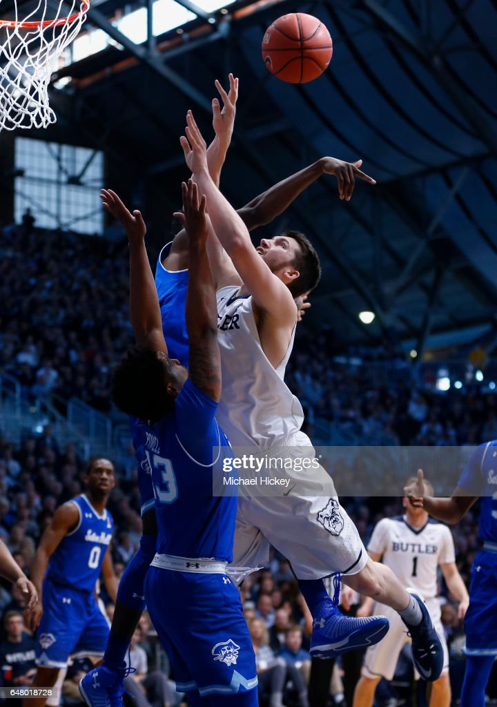 Andrew Chrabascz #45 of the Butler Bulldogs shoots the ball against Myles Powell #13 of the Seton Hall Pirates at Hinkle Fieldhouse on March 4, 2017 in Indianapolis, Indiana.