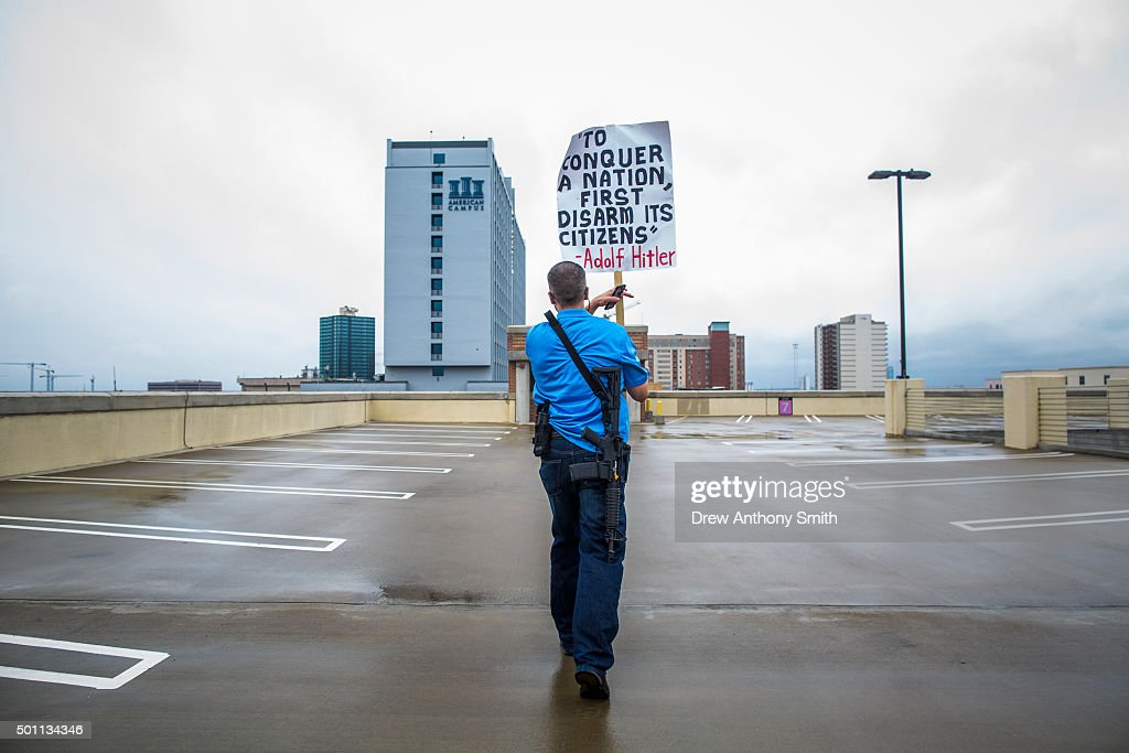 Andrew Clements along with other progun activists march close to The University of Texas campus December 12 2015 in Austin Texas In addition to the...