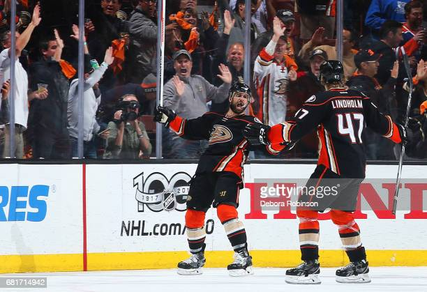 Andrew Cogliano and Hampus Lindholm of the Anaheim Ducks celebrate Cogliano's goal in the second period of Game Seven of the Western Conference...