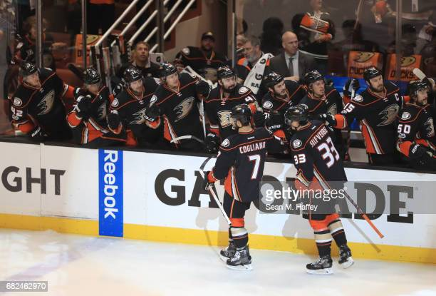 Andrew Cogliano and Jakob Silfverberg of the Anaheim Ducks skate by the Ducks bench to celebrate after Silfverberg scored in the first period against...
