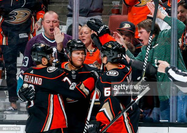 Andrew Cogliano Brandon Montour and Rickard Rakell of the Anaheim Ducks celebrate Montour's thirdperiod goal during the game against the Montreal...