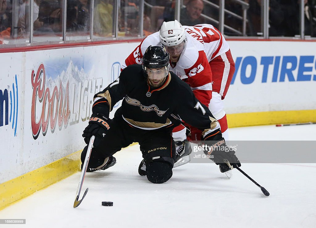 Andrew Cogliano #7 of the Anaheim Ducks and Joakim Andersson #63 of the Detroit Red Wings fight for the puck in the third period of Game Seven of the Western Conference Quarterfinals during the 2013 NHL Stanley Cup Playoffs at Honda Center on May 12, 2013 in Anaheim, California. The Red Wings defeated the Ducks 3-2.