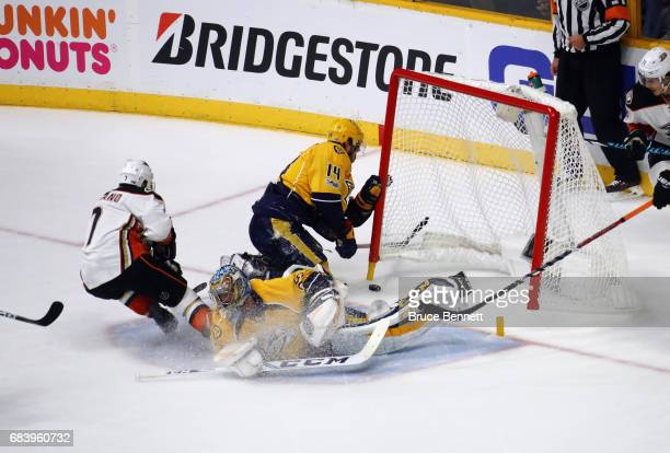 Andrew Cogliano of the Anaheim Ducks and Mattias Ekholm of the Nashville Predators react to a disallowed goal during the second period in Game Three...