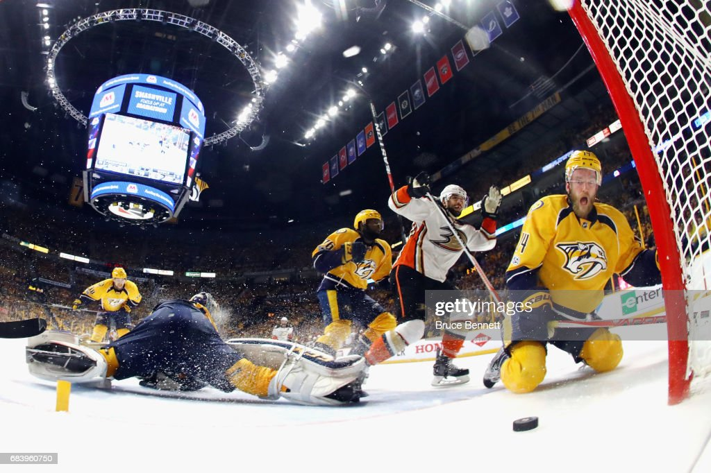 Andrew Cogliano #7 of the Anaheim Ducks and Mattias Ekholm #14 of the Nashville Predators react to a disallowed goal during the second period in Game Three of the Western Conference Final during the 2017 Stanley Cup Playoffs at Bridgestone Arena on May 16, 2017 in Nashville, Tennessee.