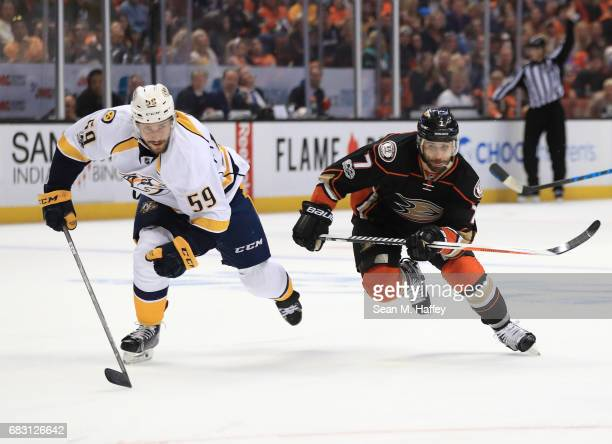 Andrew Cogliano of the Anaheim Ducks and Roman Josi of the Nashville Predators skate after a puck in the third period of Game Two of the Western...