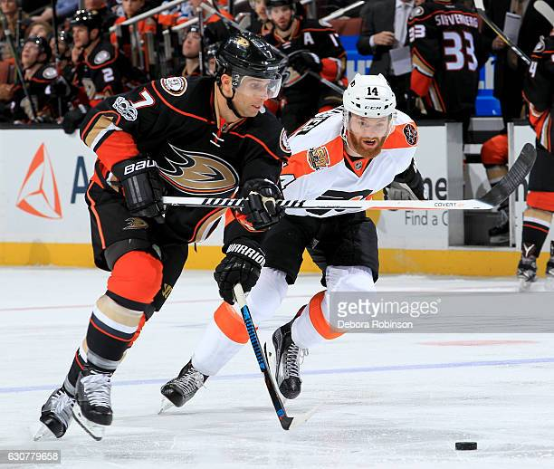 Andrew Cogliano of the Anaheim Ducks and Sean Couturier of the Philadelphia Flyers chase down the puck on January 1 2017 at Honda Center in Anaheim...