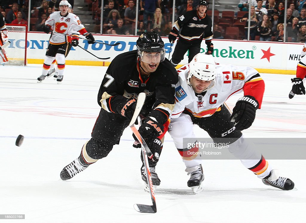 <a gi-track='captionPersonalityLinkClicked' href=/galleries/search?phrase=Andrew+Cogliano&family=editorial&specificpeople=869296 ng-click='$event.stopPropagation()'>Andrew Cogliano</a> #7 of the Anaheim Ducks battles for the puck against <a gi-track='captionPersonalityLinkClicked' href=/galleries/search?phrase=Mark+Giordano&family=editorial&specificpeople=696867 ng-click='$event.stopPropagation()'>Mark Giordano</a> #5 of the Calgary Flames on October 16, 2013 at Honda Center in Anaheim, California.