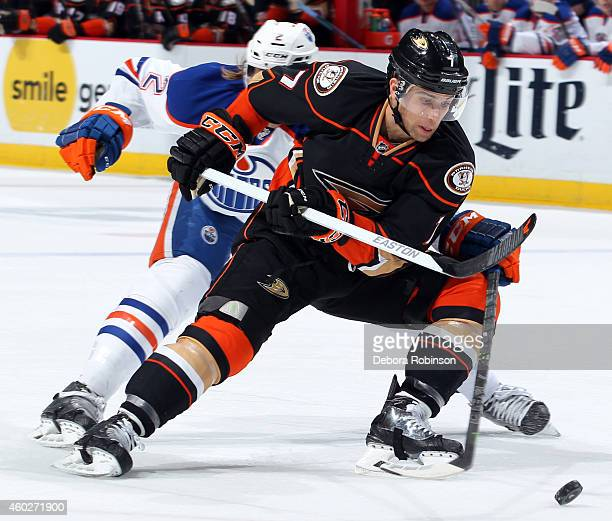Andrew Cogliano of the Anaheim Ducks battles for the puck against Jeff Petry of the Edmonton Oilers on December 10 2014 at Honda Center in Anaheim...