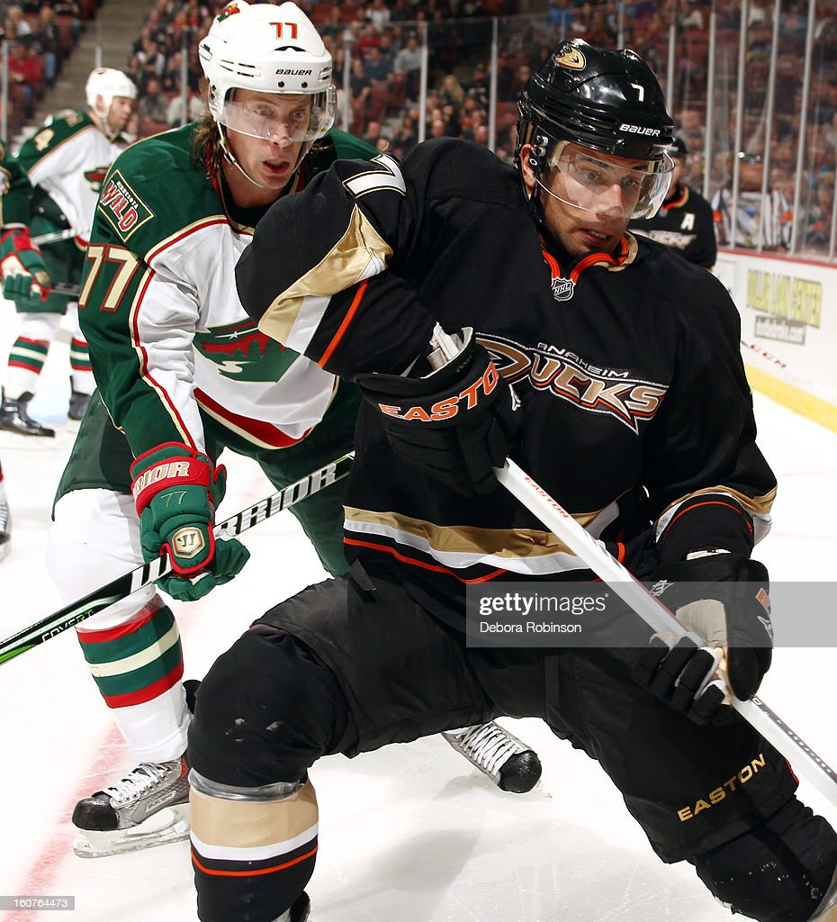 Andrew Cogliano #7 of the Anaheim Ducks battles for the puck against Tom Gilbert #77 of the Minnesota Wild on February 1, 2013 at Honda Center in Anaheim, California.
