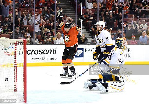 Andrew Cogliano of the Anaheim Ducks celebrates his goal in front of Ryan Ellis and Carter Hutton of the Nashville Predators to take a 30 lead during...