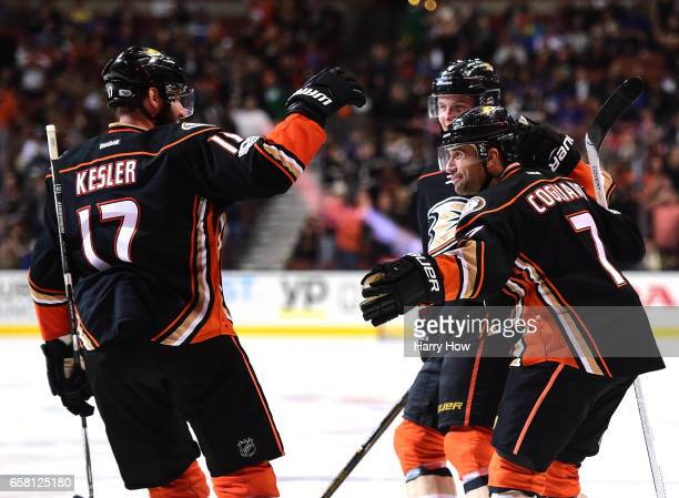 Andrew Cogliano of the Anaheim Ducks celebrates his goal with Ryan Kesler and Anaheim Ducks Cam Fowler to take a 53 lead during the third period of a...