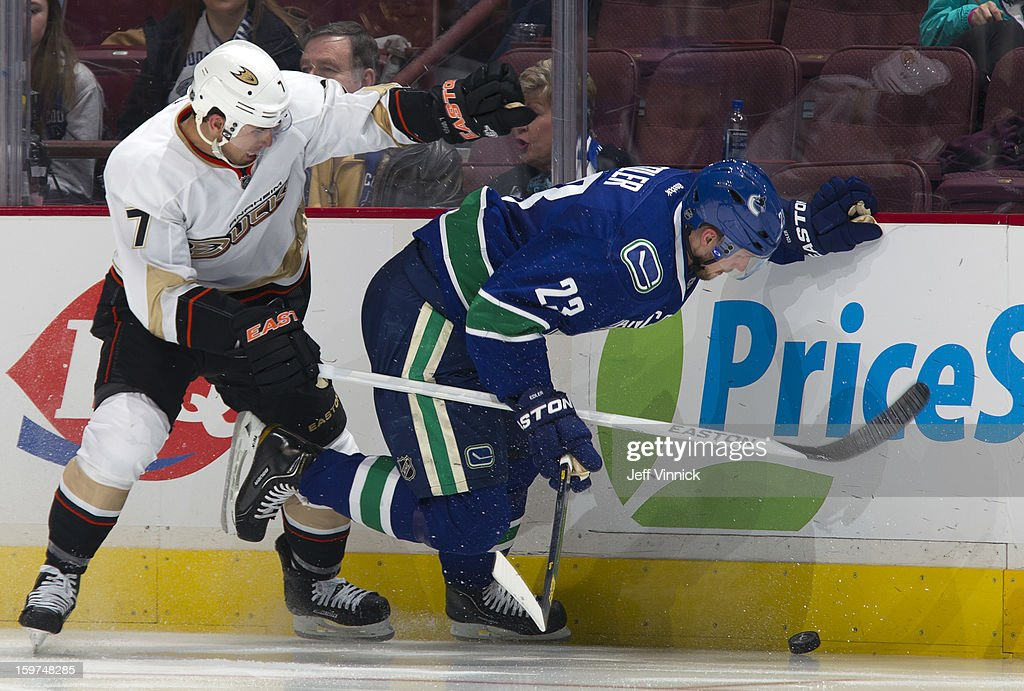 <a gi-track='captionPersonalityLinkClicked' href=/galleries/search?phrase=Andrew+Cogliano&family=editorial&specificpeople=869296 ng-click='$event.stopPropagation()'>Andrew Cogliano</a> #7 of the Anaheim Ducks checks <a gi-track='captionPersonalityLinkClicked' href=/galleries/search?phrase=Alexander+Edler&family=editorial&specificpeople=882987 ng-click='$event.stopPropagation()'>Alexander Edler</a> #23 of the Vancouver Canucks in the season-opening NHL game at Rogers Arena January 19, 2013 in Vancouver, British Columbia, Canada.