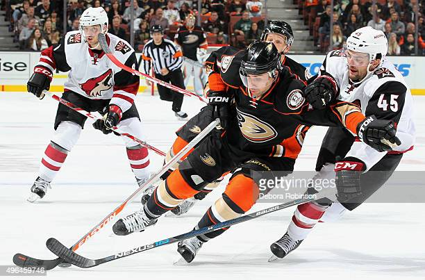 Andrew Cogliano of the Anaheim Ducks controls the puck against Stefan Elliott of the Arizona Coyotes on November 9 2015 at Honda Center in Anaheim...