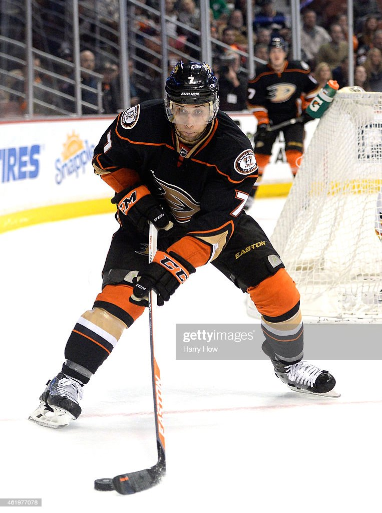 Andrew Cogliano of the Anaheim Ducks controls the puck against the Calgary Flames at Honda Center on January 21 2015 in Anaheim California