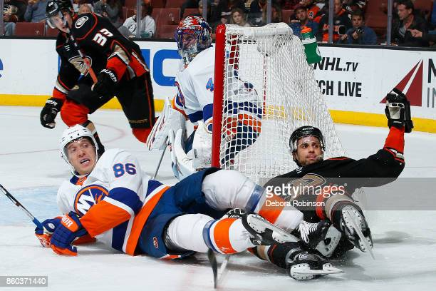 Andrew Cogliano of the Anaheim Ducks gets tangled up with Nikolay Kulemin of the New York Islanders during the game on October 11 2017 at Honda...