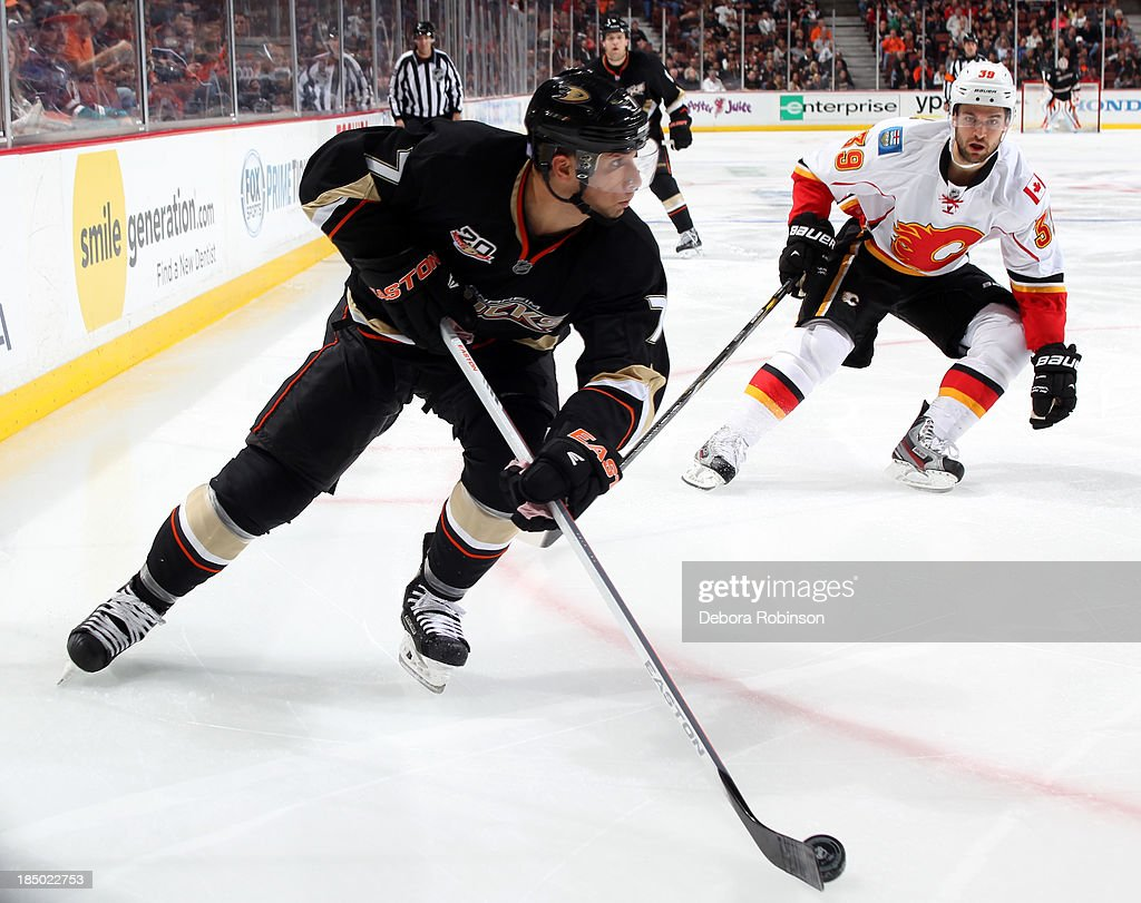 <a gi-track='captionPersonalityLinkClicked' href=/galleries/search?phrase=Andrew+Cogliano&family=editorial&specificpeople=869296 ng-click='$event.stopPropagation()'>Andrew Cogliano</a> #7 of the Anaheim Ducks handles the puck against TJ Galiardi #39 of the Calgary Flames on October 16, 2013 at Honda Center in Anaheim, California.