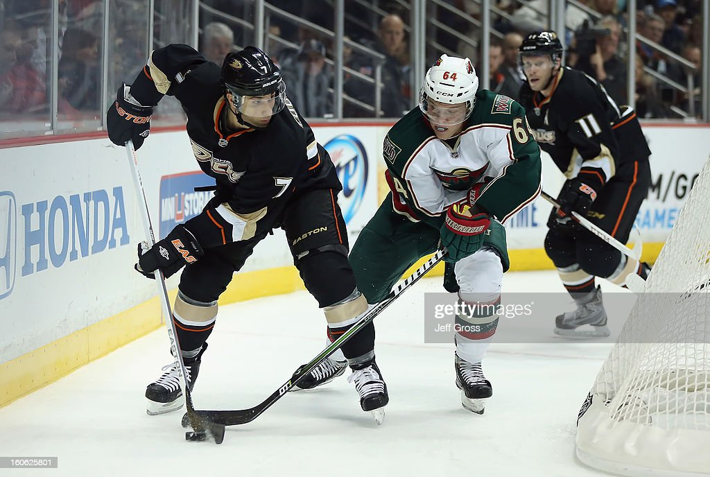 Andrew Cogliano #7 of the Anaheim Ducks is pursued by Mikael Granlund #64 of the Minnesota Wild for the puck at Honda Center on February 1, 2013 in Anaheim, California.