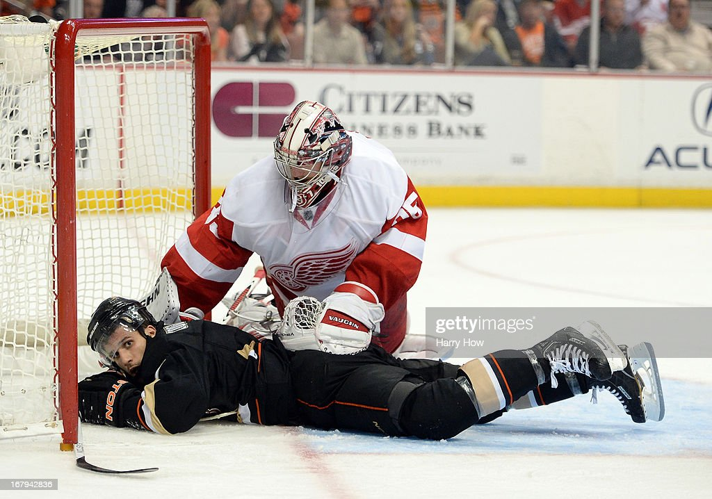 Andrew Cogliano #7 of the Anaheim Ducks lays in the crease after a cross check as Jimmy Howard #35 of the Detroit Red Wings looks on during the third period in Game Two of the Western Conference Quarterfinals during the 2013 Stanley Cup Playoffs at Honda Center on May 2, 2013 in Anaheim, California.