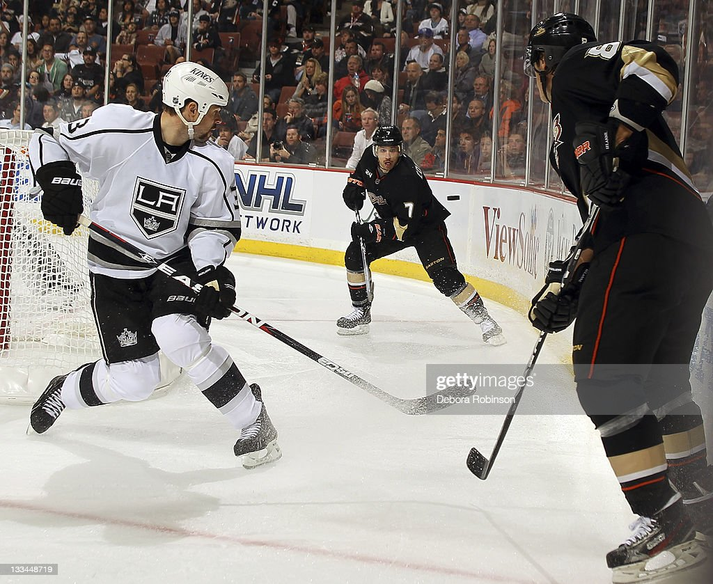 Andrew Cogliano of the Anaheim Ducks passes the puck past Willie Mitchell of the Los Angeles Kings during the game on November 17 2011 at Honda...