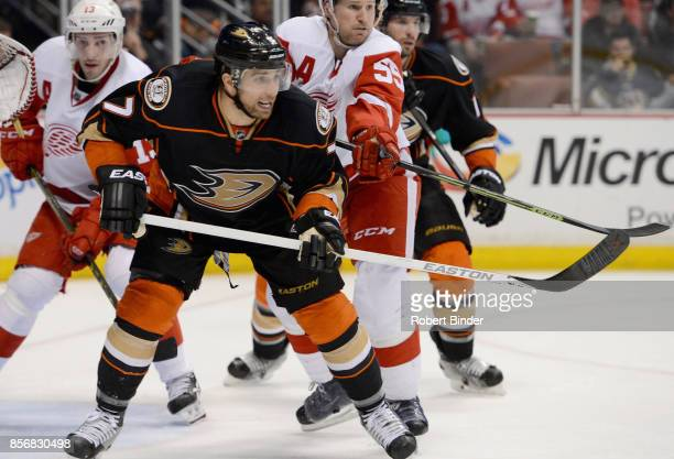 Andrew Cogliano of the Anaheim Ducks plays in a game against Pavel Datsyuk and Niklas Kronwall of the Detroit Red Wings at Honda Center on February...