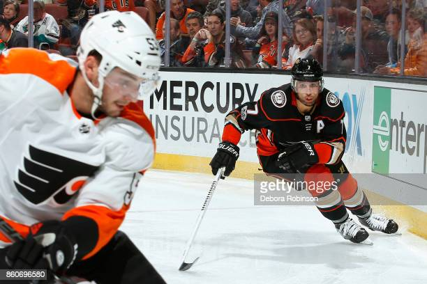Andrew Cogliano of the Anaheim Ducks puts the pressure on Shayne Gostisbehere of the Philadelphia Flyers during the game on October 7 2017 at Honda...