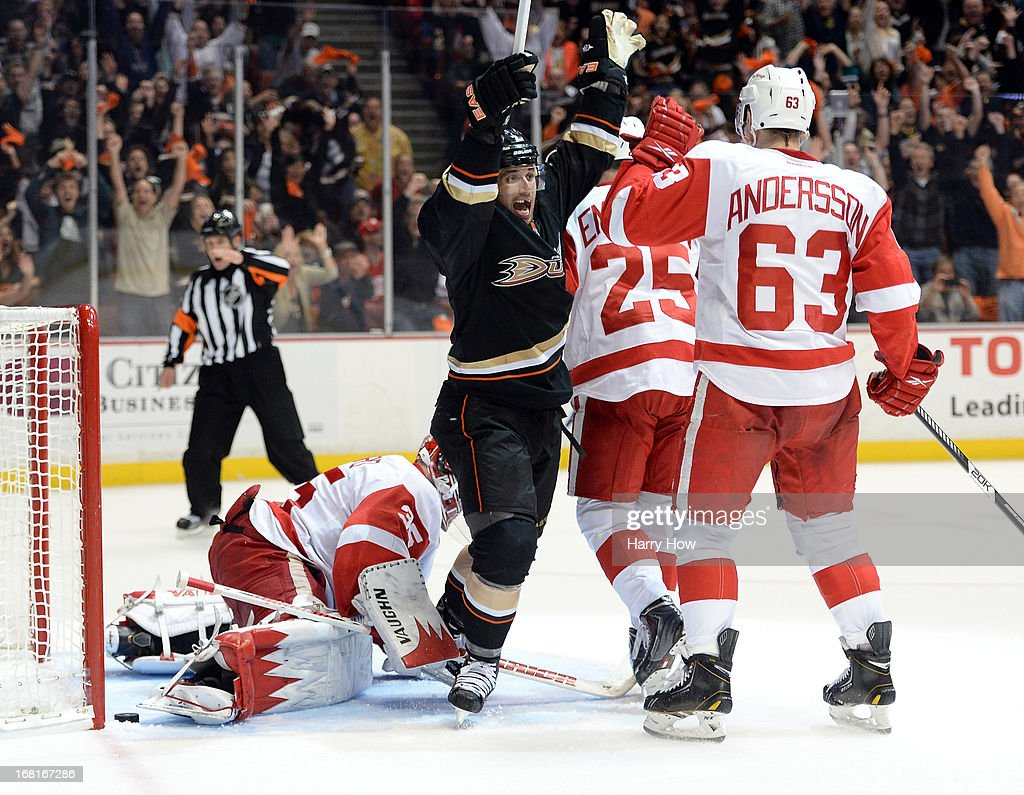 Andrew Cogliano #7 of the Anaheim Ducks reacts to Bobby Ryan's #9 goal in front of Joakim Andersson #63 and Jimmy Howard #35 of the Detroit Red Wings during a 5-4 Red Wings overtime win in Game Two of the Western Conference Quarterfinals during the 2013 Stanley Cup Playoffs at Honda Center on May 2, 2013 in Anaheim, California.