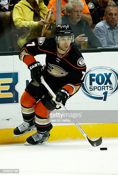 Andrew Cogliano of the Anaheim Ducks skates with the puck during the first period of a game against the Arizona Coyotes at Honda Center on October 14...