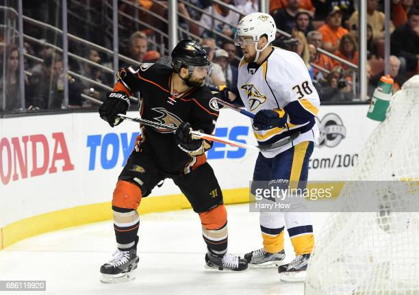 Andrew Cogliano of the Anaheim Ducks takes a crosscheck from Viktor Arvidsson of the Nashville Predators in the third period of Game Five of the...