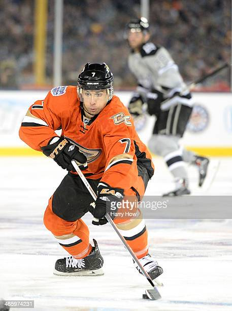 Andrew Cogliano of the Anaheim Ducks takes control of the puck against the Los Angeles Kings during the 2014 Coors Light NHL Stadium Series at Dodger...