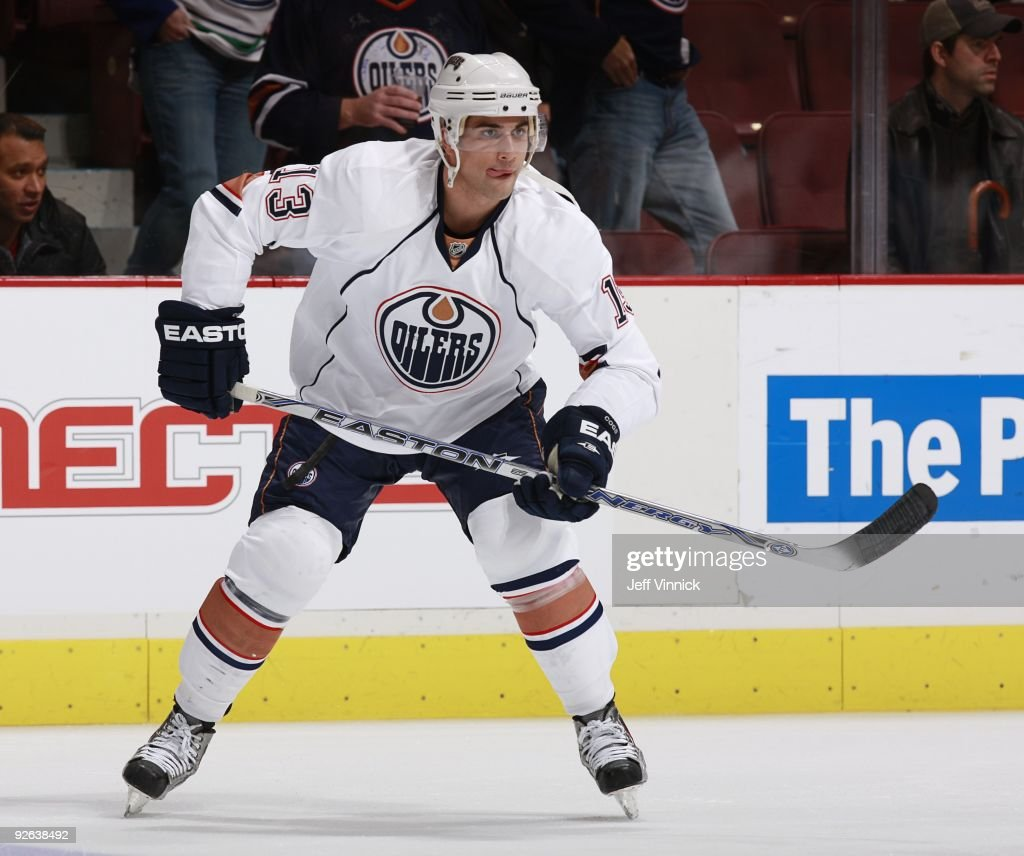 Andrew Cogliano of the Edmonton Oilers skates up ice during their game against the Vancouver Canucks at General Motors Place on October 25 2009 in...