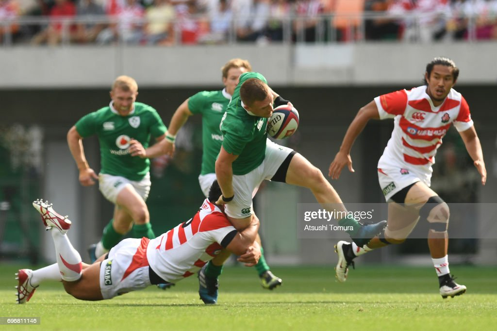 Andrew Conway of Ireland (R) is tackled by Yusuke Niwai of Japan (L) during the international rugby friendly match between Japan and Ireland at Shizuoka Stadium on June 17, 2017 in Fukuroi, Japan.