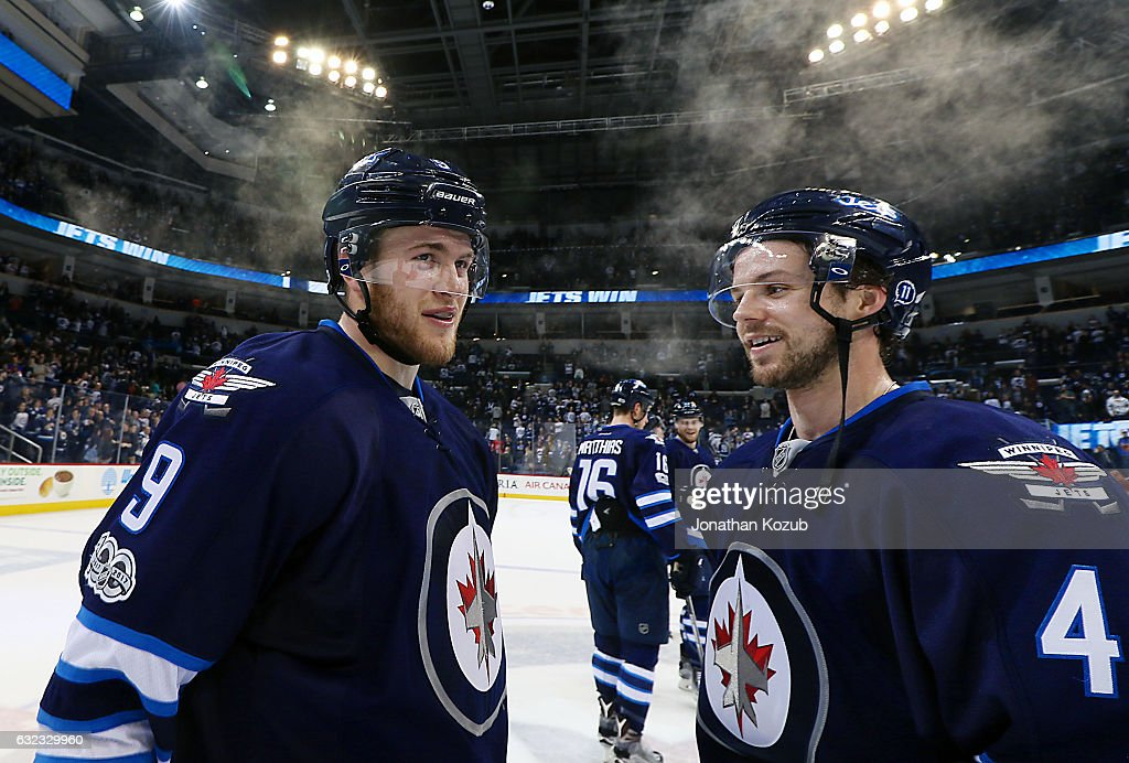 Andrew Copp #9 and Josh Morrissey #44 of the Winnipeg Jets are all smiles following a 5-3 victory over the St. Louis Blues at the MTS Centre on January 21, 2017 in Winnipeg, Manitoba, Canada.
