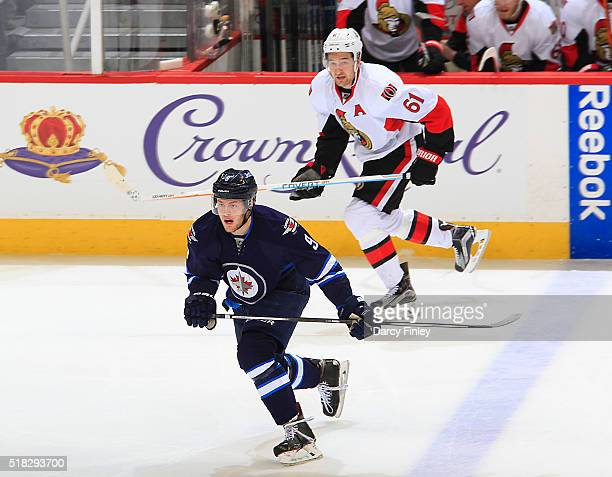 Andrew Copp of the Winnipeg Jets and Mark Stone of the Ottawa Senators follow the play down the ice during second period action at the MTS Centre on...