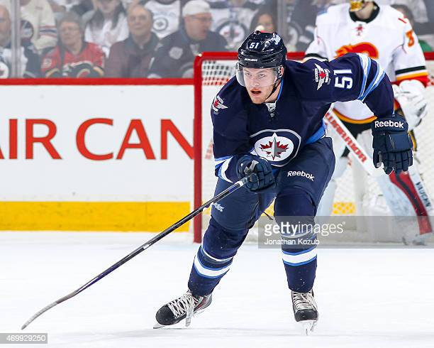Andrew Copp of the Winnipeg Jets follows the play down the ice during first period action against the Calgary Flames on April 11 2015 at the MTS...