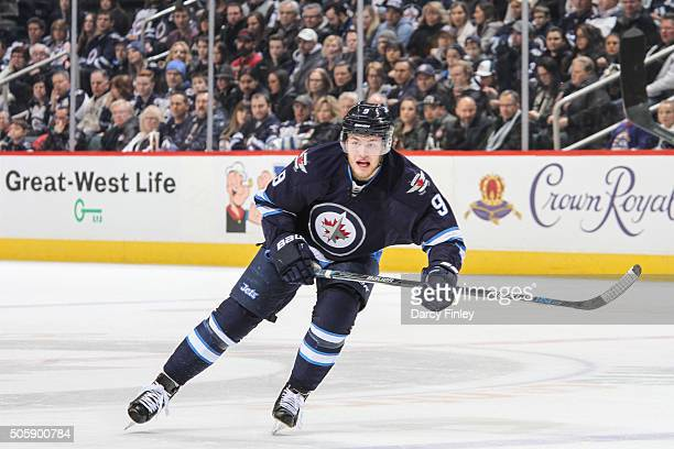 Andrew Copp of the Winnipeg Jets follows the play down the ice during first period action against the Nashville Predators at the MTS Centre on...