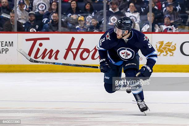 Andrew Copp of the Winnipeg Jets follows the play down the ice during first period action against the St Louis Blues at the MTS Centre on January 21...