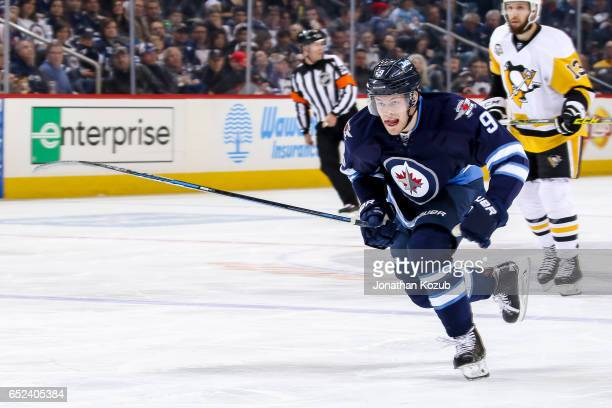 Andrew Copp of the Winnipeg Jets follows the play down the ice during second period action against the Pittsburgh Penguins at the MTS Centre on March...