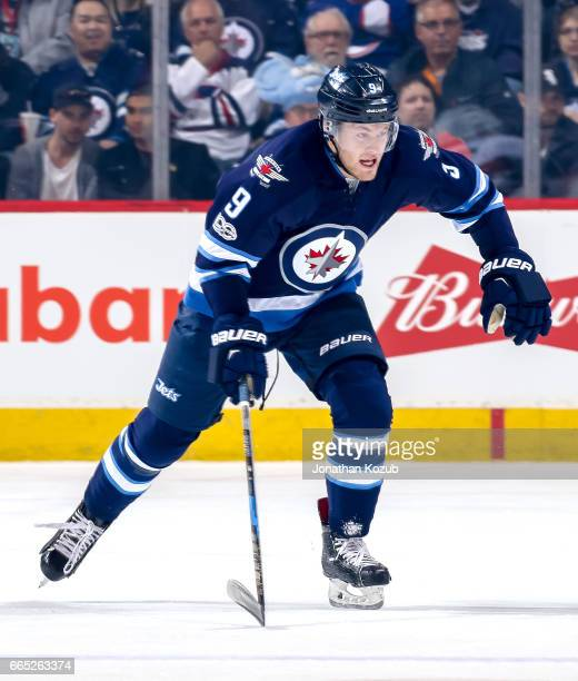 Andrew Copp of the Winnipeg Jets follows the play down the ice during first period action against the Ottawa Senators at the MTS Centre on April 1...