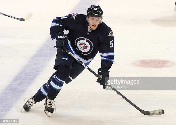 Andrew Copp of the Winnipeg Jets follows the play during second period action against the Calgary Flames on April 11 2015 at the MTS Centre in...