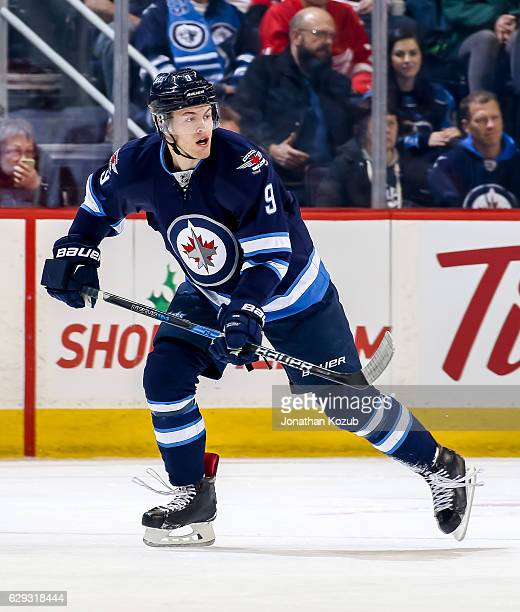 Andrew Copp of the Winnipeg Jets follows the play up the ice during first period action against the Detroit Red Wings at the MTS Centre on December 6...