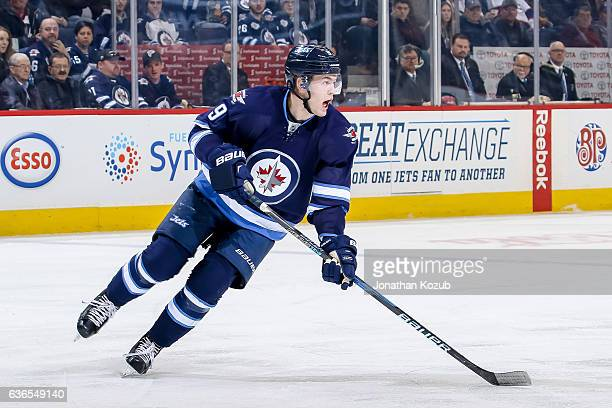 Andrew Copp of the Winnipeg Jets follows the play up the ice during first period action against the Colorado Avalanche at the MTS Centre on December...
