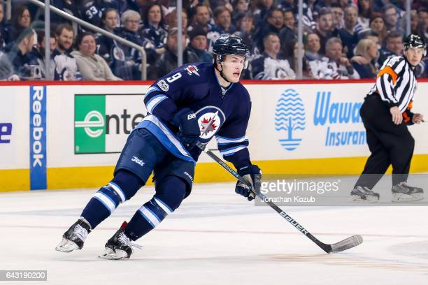 Andrew Copp of the Winnipeg Jets follows the play up the ice during first period action against the Dallas Stars at the MTS Centre on February 14...